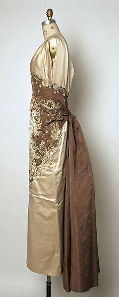 """Oriane""  Designer: Pierre Balmain  fall/winter 1954–55 Culture: French Medium: silk, glass, shells"
