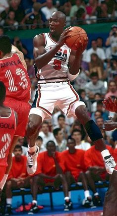 d28d5cf7a8f Michael Jordan---- contorts in air to get a shot off against Angola in Team  USA's 1992 Summer Olympic matchup in Barcelona.The Dream Team crushed every  team ...