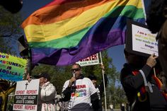 Supporters and opponents Tuesday in front of the U.S. Supreme Court as it hears oral arguments to settle the question of the states to grant  same-sex marriage licenses, and to recognize those performed in other states