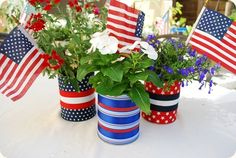 wrap soup cans with ribbon and fill with a small potted flower for a double-duty centerpiece and giveaway.  Just be sure to clean the can and have an adult (carefully!) sand the top ridges.