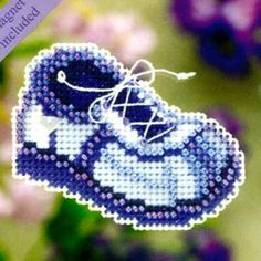 Blue Sneaker - Spring Bouquet 2011 - Mill Hill Counted Glass Bead Ornament Kit with Treasure MH181101. A charming baby boy's blue sneaker -- for every mother and grandmother! Makes one Pink Sneaker Mill Hill counted cross stitch glass bead ornament. Finished Size: 2.5 x 2 inches.