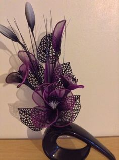 Artificial Flower Arrangement Made With Purple Nylon Flowers In Black Vase Calla Lily Flowers, Nylon Flowers, Shade Flowers, Balloon Flowers, Diy Flowers, Fabric Flowers, Artificial Flower Arrangements, Artificial Flowers, Nylon Crafts