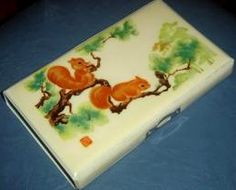 Chinese pencil case. It was padded and soft at the touch and was closing with magnet. Mine had the same design and colors.