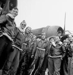 Not published in LIFE. Jubilant B-17 crew members pose next to their plane upon returning to England unscathed after a bombing run, 1942.