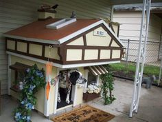 Homemade dog house. Very fancy! The dog seems impressed, don't you think? Love it!