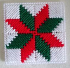 Pretty, quilt-block inspired pattern, Christmas coasters. Made with 7 count plastic canvas and stitched in red, white, and green worsted weight yarn. Sold in sets of 4 (four). Coasters are backed with a color-coordinated felt. Each one measures approximately 4 across. Nice addition to your holiday table setting.