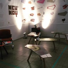 Four #KIDNEYTABLE 's on the floor / many designs on the wall / Presented @loft.karlsruhe / #grafik  #interior #design #coffeetable #table #handmade #madeincologne at the #neunoy #workshop