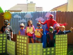 Superhero party cute for a group picture after everyone finishes super hero training