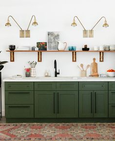 Green Kitchen Cabinets in Kitchen with Open Shelving via Little Green Notebook