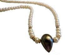 Tahitian Pearl necklace- Side drilled teardrop baroque on Chinese button pearls.