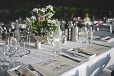 Personalised place mats and potted plants for centrepieces
