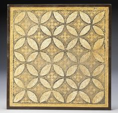 A Roman geometric mosaic panel  Circa 3rd-4th Century A.D. Composed of black, white, yellow and grey tesserae arranged in a pattern of intersecting discs with central cruciform motifs, 25½in x 25in (65cm x 63cm), mounted