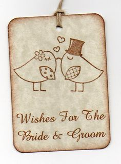 Cute idea... a wish tree... guests write on these sweet tags and hang them on a tree!!