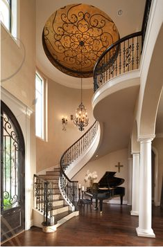 I love the stair case and the ceiling art and the front door and the columns and… More