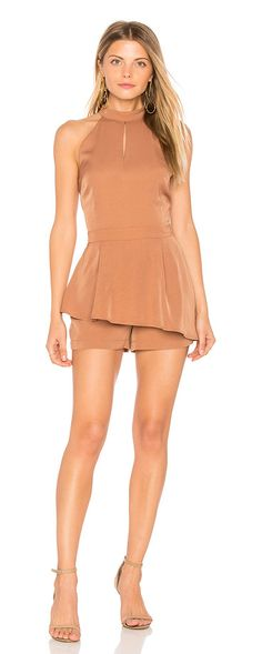 Halter Neck Cut Out Romper by J.O.A.. Self: 100% polyLining: 100% rayon. Hand wash cold. Front keyhole cut-out. Pleated skirt overlay. Back cut-out with button closure. Hidden back zipper closure. Body measures approx 28 in lengthLeg opening measures approx 25. JOA-WR28. BC5... #joa #dresses