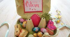 Geschenkidee zu Ostern. Aus einem Eierkarton ein Osternest basteln.