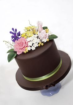 This is a take on the fabulous cakes that Jacqueline Butler from Petalsweet Cakes does – obviously her's are WAY better, but I do love the flowers against the dark chocolate fondant. Anyway this was my non-wedding cake (long story) and it is. Chocolate Fondant, Love Chocolate, Chocolate Lovers, One Layer Cakes, Single Layer Cakes, Beautiful Cakes, Amazing Cakes, Fondant Elephant, Spring Cake