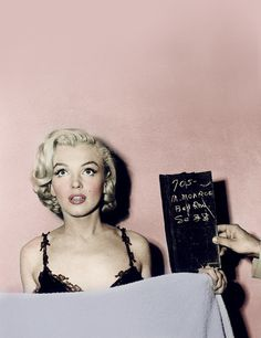 "Marilyn - ""A kiss on the hand may be quite continental but diamonds are a girl's best friend..."""