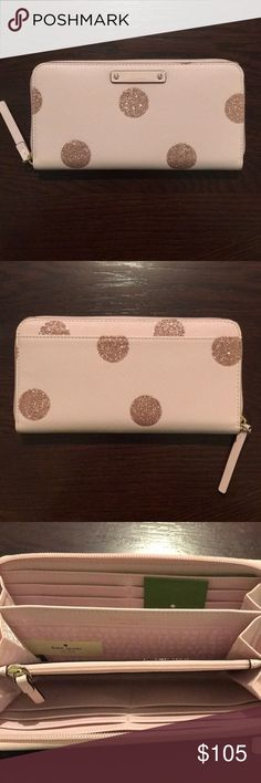 Kate Spade Wallet - Brand New with Tags! Kate Spade Wallet - Brand new with tags! Color is light pink and features glitter polka dots which gives it a nice sparkle! Inside contains a zipper coin pouch in the middle and each side of the wallet has 6 card slots. Style is neda - haven lane.   Matching purse also listed. Please bundle if interested in both the purse and wallet! kate spade Bags Wallets