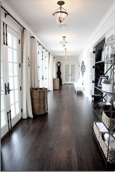 Dark hardwood floors and light walls. Love it