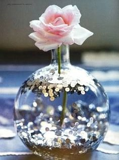 love love love this idea!! Sequins… in water. Budget-friendly centerpiece idea | by Holly Becker