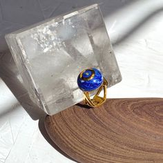 'Lapis is one of the oldest spiritual stones known to man, used by healers, priests and royalty, for power, wisdom and to stimulate psychic abilities and inner vision. It represents universal truth and is connected to the 3rd eye chakra.' Silver Core ,18k Gold-plated ,Lapis Lazuli and Brown Diamonds