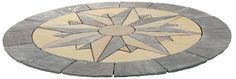 Each segment of this Vintage Manor Compass decorative patio paving circle is hand cut from 3 colours of natural sandstone and the completed design measures 2.7 mtrs in diameter. #PavingCircles #DecorativePavingCircles