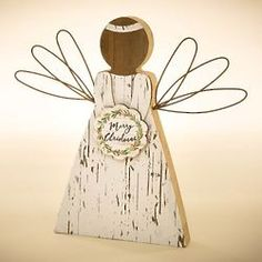 A small Merry Christmas wreath is held like a bouquet on this rustic angel. With bent wire wings, it creates a special touch as it stands on their mantel or other place of honor in their home. Christmas Angels, Christmas Wreaths, Merry Christmas, Religious Gifts, Wood And Metal, Wings, Rustic, Merry Little Christmas, Country Primitive
