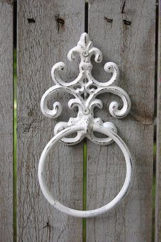 Hand painted cast iron towel holder, done in white, lightly distressed and finished with a protective clear coat. Painted mounting screws are included. **Available with matching bath tissue holder her