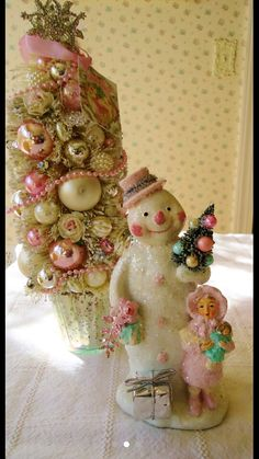 Cute snowman  with bottle brush tree.