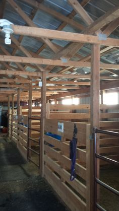 "Homemade box stalls - made with 2 x and 4 x I like the idea of the half-walls, but I would want the walls to be solid, without gaps, in case the horses kicked out or ""climbed"" the walls Cattle Barn, Farm Barn, Barn Stalls, Horse Stalls, Rinder Stall, Barn Layout, Horse Barn Designs, Horse Shelter, Horse Barn Plans"