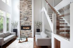 Love the open stairs and and fireplace in this livingroom