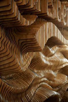 Creative agency Wonderland Created A Wall For Carlsberg From 160 Laser Cut Pieces Of Wood