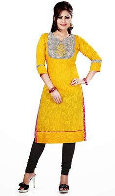 Off white and yellow cotton kurti adds charm and grace to your beauty as this  bright kurti is beautified with digital print, applique, silk thread and lace. #StylishClassicalKurtis