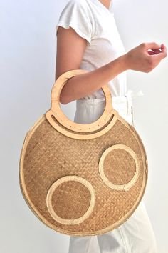 Straw, wicker, rattan, and raffia—this summer, we're officially obsessed with woven bags.