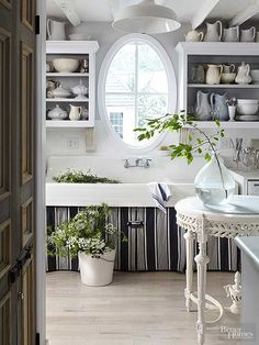 Vintage mixed with contemporary offers an unexpected aesthetic balance that home design trendwatchers have come to embrace. That can include reclaimed products -- here, an oversize farmhouse sink -- paired with decidedly up-to-date elements, such as thesleek whitewashed floor./