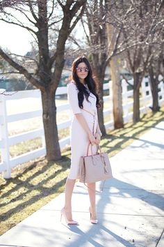 Rachel Parcell is looking fabulously feminine in this blush pink dress and  cardigan combination, paired