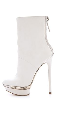Brian Atwood white platform boots with snake skin and metal detail.