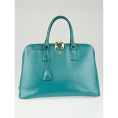 Pre-owned Prada Turchese Saffiano Vernice Leather Top Handle Bag... (30.000.225 VND) ❤ liked on Polyvore featuring bags, handbags, structured handbag, leather top handle bag, top handle bag, triangle bag and prada purses