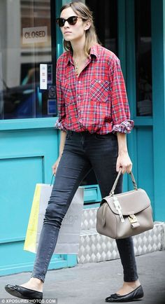 Alexa Chung: half ponytail + shades + plaid button-down + grey skinny jeans + flats : effortless, tucked in, rolled up sleeves
