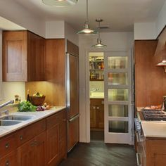 I love the glass paneled pocket door between this kitchen and pantry/laundry room. It separates the rooms but allows light to flow between the two.