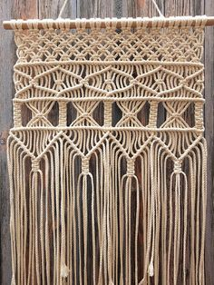 Macrame wall hanging in boho style, wall tapestry, retro 70s. My macrame wall hanging is the perfect decoration object for your home. This beautiful item brings a touch of romance to the atmosphere of your room. Dimensions: Wood width - 43 cm (16.9 ) Macrame height - 80 cm (31.5