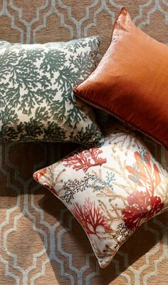 With a coral motif in velvet flocking, the Coralita Spa Decorative Pillow adds a tropical, textural accent to any living space.