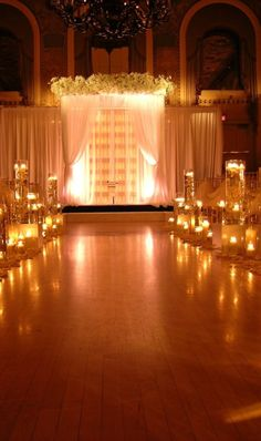 Gorgeous ceremony in the Gold Ballroom at the Hotel du Pont with draping and design Evantine Design   www.Hoteldupont.com/weddings