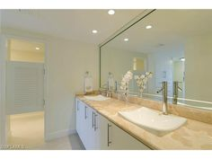 Coastal contemporary bathroom remodel in the Allegro Park Shore.   Learn everything you ever wanted to know about the Allegro beach high rise in Park Shore | Naples, Florida |