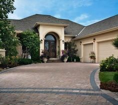 Create a patterned driveway using different paver colors and patterns. Paver Driveway Cost, Driveway Design, Patio Design, Carriage House Apartments, Belgard Pavers, Outdoor Paving, Walkways, Driveways, Paver Designs