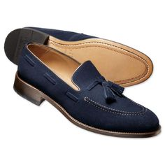 Navy suede tassel loafers.