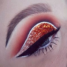 Ok, I'm back to dousing my eyes in glitter now ✨... PRODUCTS: @makeupaddictioncosmetics Vintage and Flaming Love palette shadows. Glitters are @mehronaustralia Orange Harvest, @shopvioletvoss Copperella , @kaoir Invisible glitter and the chunky copper glitter is from Spotlight. White liner is @inglot_australia 76 gel liner. Winged liner: @katvondbeauty Witches liquid lip + Tattoo liner to sharpen edges. Brow: @anastasiabeverlyhills Dip brow in Taupe + Med Brown.