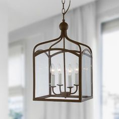 Bring the outdoors inside with this elegant four-light chandelier that is reminiscent of a lantern.