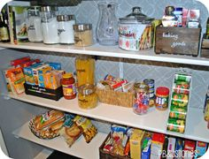 Kitchen Pantry Reveal ! - Seriously cool ideas for those cans - but need to find a wider folder organizer that would fit those big hunts tomato sauce cans
